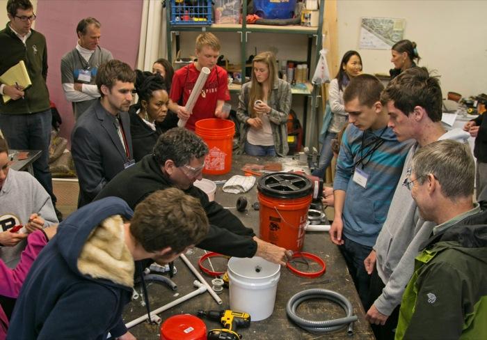 Culhane teaches participants to build a mini biodigester