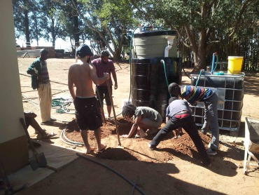 The Solar CITIES Swaziland team finishing up the biodigester for grandpa Simon's farm.