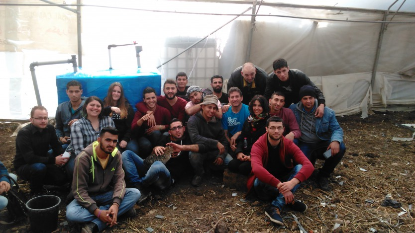 """Solar CITIES, Envisaj Mercy and Palestinian Polytechnic students build our """"refugee camp"""" IBC based biodigester in a greenhouse at Hakoritna Farm"""